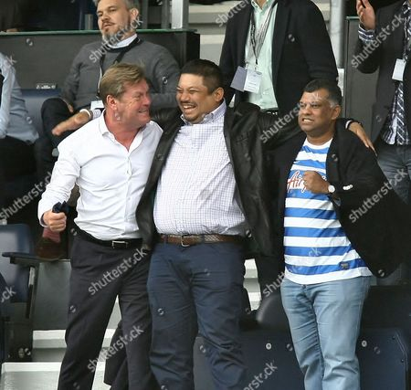 QPR owners celebrate after the final whislte -QPR chief executive Philip Beard ( 1st from left) and  QPR Chairman  Tony Fernandes (3rd from left)