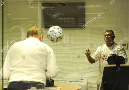 21.10 A lighter moment as QPR owner Tony Fernandes takes time out to practice some head tennis with CEO Philip Beard