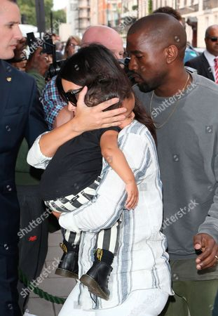 Kim Kardashian West, Kanye West and North West arriving at their London hotel