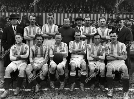 Brighton and Hove Albion team - 1927 / 1928 season -  Back (l-r): Charlie Webb (Secretary/Manager), Reginald Wilkinson, Jenkins, Reg 'Skilly' Williams, trainer, Jack Curran, Albert Sykes, Director. Sitting: Tommy Simpson, James, Thomas 'Tommy' Cook, James 'Jimmy' Hopkins (also Arsenal), Ernie 'Tug' Wilson, Paul Mooney.