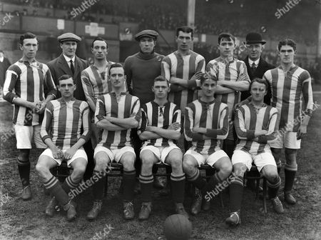 Stock Image of Football - 1914 / 1915 FA Cup - First Round: Aston Villa 2 Exeter City 0 Exeter City team group at Villa Park on Back (l-r): Ripley, Pratt, Marshall, Dick Pym (goalkeper), Strettle, Lagan, Arthur Chadwick (Manager) Smith. Front: Holt, Evans, Fred Goodwin, Lovett, Dockray.