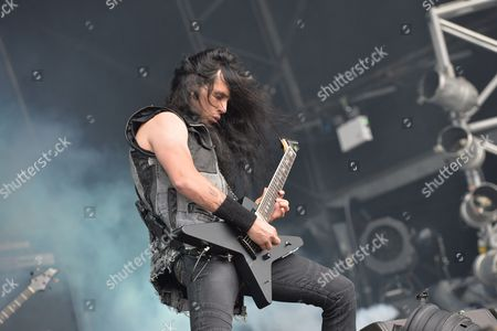 Walton-on-trent United Kingdom - August 9: Guitarist Kostas Karamitroudis Better Known By His Stage Name Gus G Of Heavy Metal Group Firewind Performing Live On Stage At Bloodstock Open Air Festival In Derbyshire England On August 9