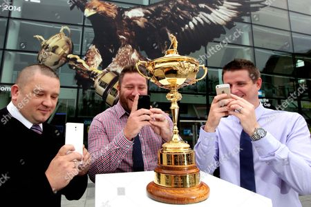 The Ryder Cup in Edinburgh ahead of it's tour of Scotland ahead of the event to be held at Gleneagles. Majec Koryczan, Gary Summers and Fraser Allison from Edinburgh.