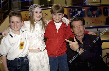 PIERCE BROSNAN WITH SOPHIE VAVASSEUR (2ND L) AND COSTARS