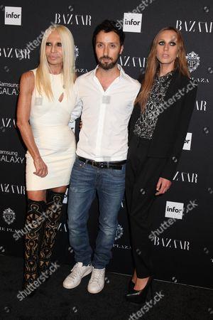 Stock Photo of Donatella Versace, Anthony Vaccarello and Allegra Beck Versace