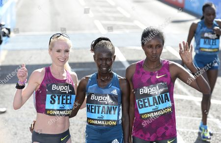 Mary Keitany (centre) celebrates winning the women's BUPA Great North Run 2014 with 2nd place Gemma Steel (left) and 3rd Tiki Gelana