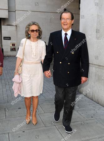 Kristina Tholstrup and Sir Roger Moore