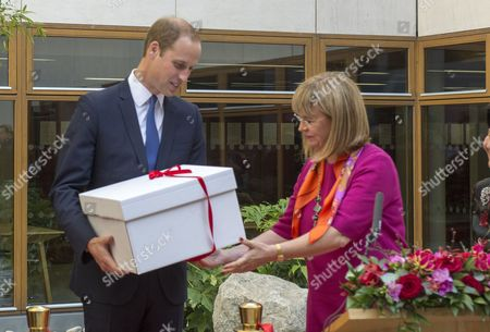 Stock Picture of Prince William receiving a gift from the Principal Dame Elish Angiolini