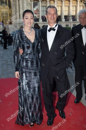 Stock Image of Gong Li and Philippe Leopold-Metzger, President de Piaget
