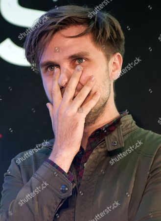 Tom Butler from Wandsworth reacts after hearing the news he is the overall winner of the Gigs Songwriting Prize