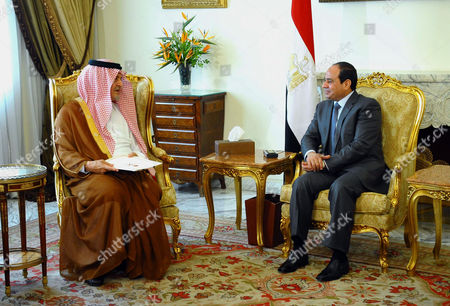 Egyptian President Abdel Fattah el-Sissi, meets with Saudi Foreign Minister Prince Saud al-Faisal at the presidential palace in Cairo