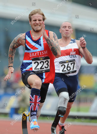 Alan Tate of Great Britain wins the 200m race