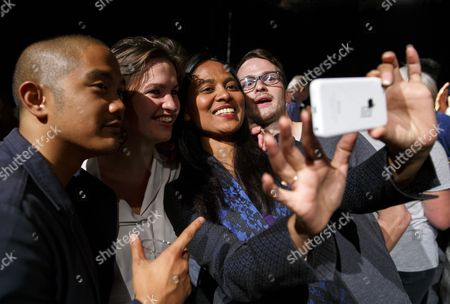 Rushanara Ali, MP for Bow and Bethnal Green, takes a 'selfie' with young people