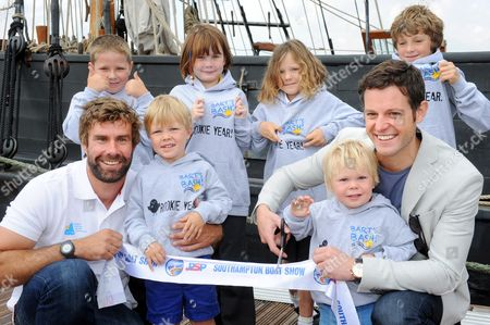 Matt Baker and Olympic Gold medallist Iain Percy with local children