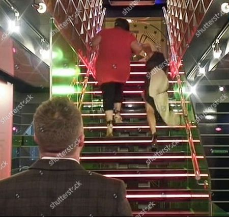 Edele Lynch slips up the stairs as she leaves the house with Dee Kelly