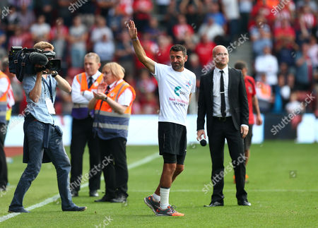 An emotional former Southampton player Francis Benali waves to the fans after completing his 'Benali's run' around every Premier League stadium