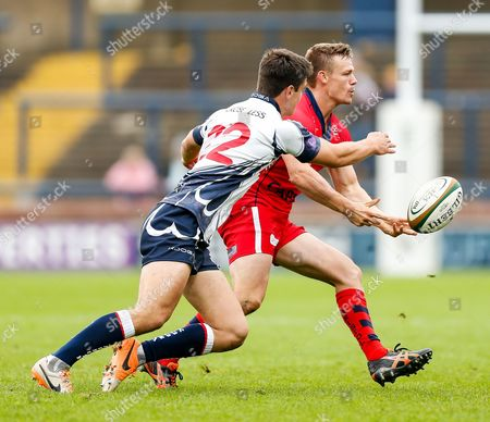 Stock Photo of Bristol Scrum-Half Dwayne Peel (capt) offloads as Yorkshire Carnegie replacement Harry Leonard tackles
