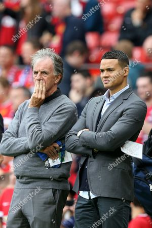 Stock Photo of Match of the Day 2 Pundits Mark Lawrenson and Jermaine Jenas watch the teams warm up