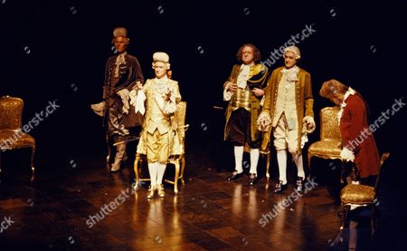The Emperor listens to a composition by Wolfgang Amadeus Mozart. Cast including Andrew Cruickshank (centre), Paul Scofield as Salieri and Simon Callow as Mozart (rhs).