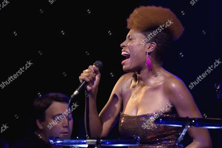 Stock Picture of Franco-Cameroonian singer Sandra Nkake sings Ray Charles at the Cabaret Sauvage in a creation by pianist Eric Legnini (with singers Alice Russel and Elena Pinderhughues)