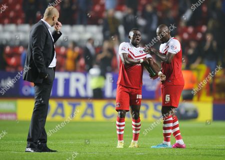 Stock Photo of Charlton Athletic Manager Bob Peeters looks on as Andre Bikey tends to the injured Igor Vetokele