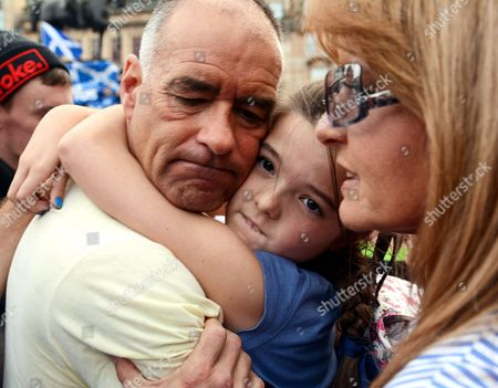 Tommy Sheridan, his daughter and wife