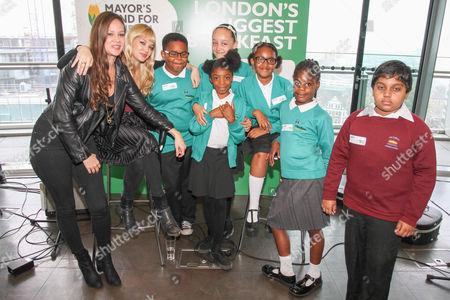 Allison Pierce and Catherine Pierce with schoolchildren