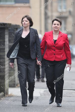 Scottish Conservative leader Ruth Davidson (in red) casts her vote at the Glasgow Gaelic School, with her partner Jennifer Wilson.