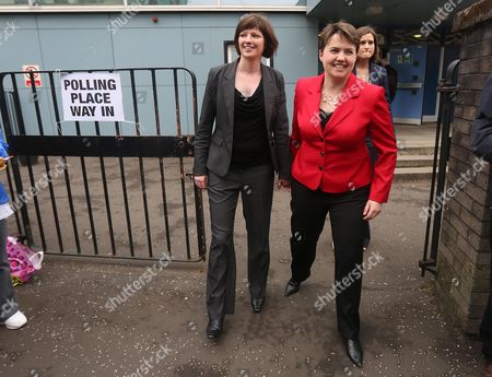 Stock Picture of Scottish Conservative leader Ruth Davidson (in red) casts her vote at the Glasgow Gaelic School, with her partner Jennifer Wilson.
