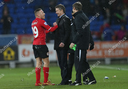 Cardiff's manager Ole Gunnar Solskjaer celebrates the win with Cardiff's Craig Bellamy at his first home win.