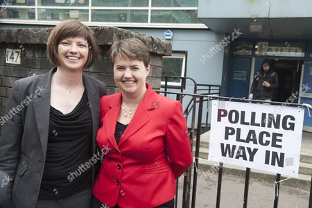 Stock Photo of Scottish Conservative leader Ruth Davidson (in red) casts her vote at the Glasgow Gaelic School, with her partner Jennifer Wilson.
