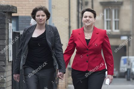 Stock Image of Scottish Conservative leader Ruth Davidson (in red) casts her vote at the Glasgow Gaelic School, with her partner Jennifer Wilson.