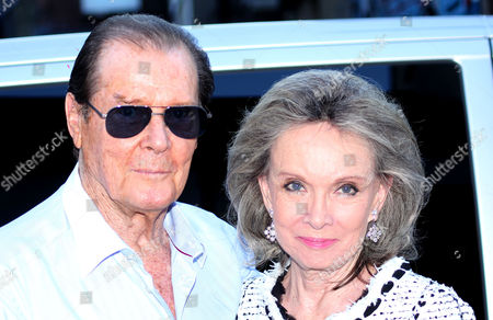 Stock Image of Sir Roger Moore and Kristina Tholstrup