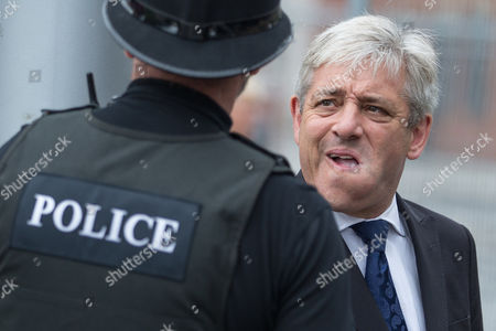 Stock Photo of The Speaker of the House of Commons John Bercow Talking to a Policeman Outside the Cathedral