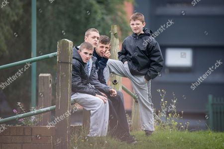 Youths watch from across the road