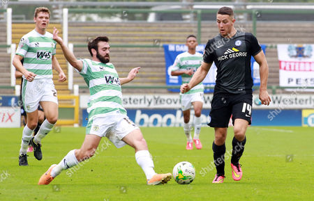 Peterborough United's Conor Washington in action with Yeovil Town's Jack Price