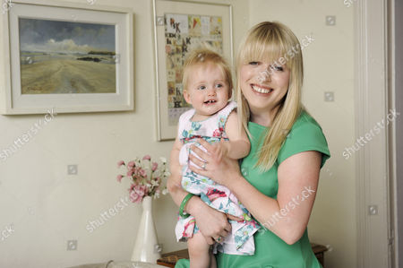 Editorial photo of Kitty Dimbleby With Her Daughter Chloe Dimbleby 12 Months Old. Gruelling Ivf A Complicated Pregnancy That Led To Elephantine Legs Iron Transfusions And Bowel Shutdown Then An Emergency C-section. But Kitty Dimbleby Would Go Through It All Again For H