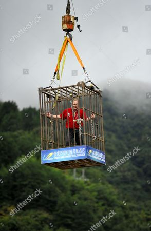 Editorial photo of Chained escapologist escapes from cage dangling above lake, Zhangjiajie city, Hunan province, China - 19 Sep 2014