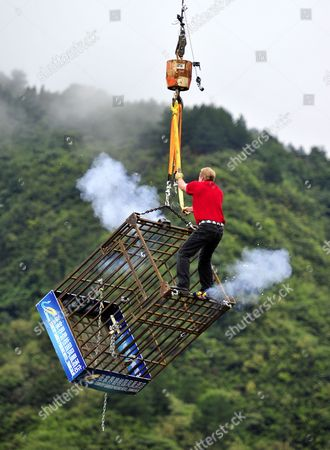 Stock Photo of Canadian escapologist Dean Gunnarson escapes from the cage