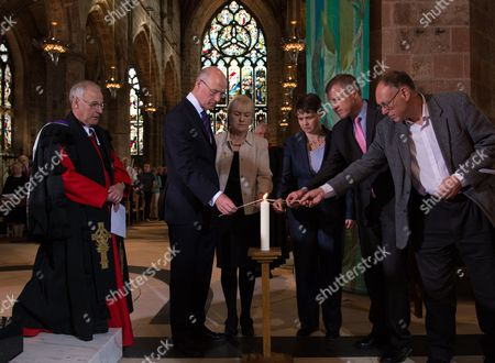 The Moderator of the Church of Scotland, Right Reverend John Chalmers, led a Service of Reconciliation at St Giles Cathedral, Edinburgh, this morning. Scottish political leaders were in attendance coming together to light a ceremonial candle. Taking part were l-r John Swinney, Johann Lamont, Ruth Davidson and Willie Rennie and Green representative Ian Baxter. At left is the Very Reverend Dr Finlay Macdonald. Also at the church was Better Together campaign leader Alistair Darling.