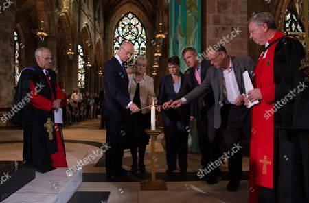 The Moderator of the Church of Scotland, Right Reverend John Chalmers, led a Service of Reconciliation at St Giles Cathedral, Edinburgh, this morning. Scottish political leaders were in attendance coming together to light a ceremonial candle. Taking part were l-r John Swinney, Johann Lamont, Ruth Davidson and Willie Rennie and Green representative Ian Baxter. At left is the Very Reverend Dr Finlay Macdonald to the right is Moderator Rev John Chalmers. Also at the church was Better Together campaign leader Alistair Darling.