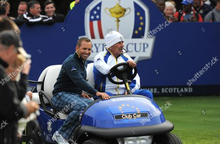 Sergio Garcia of Team Europe hitches a ride with Vice Captain Sam Torrance