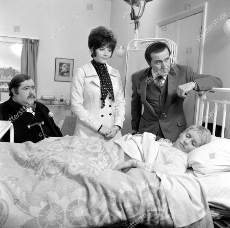 Stock Image of Patrick Newell, Linda Thorson, Patrick Macnee and Sally Nesbitt