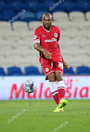 Cardiff City interim coach Danny Gabbidon plays the ball forward after being included in the starting lineup