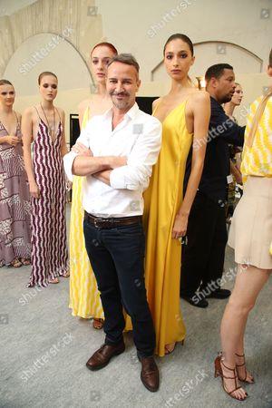 Designer Marcel Marongiu and models backstage