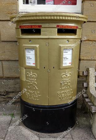 Gold Royal Mail post box celebrating Gold medal winner Peter Wilson