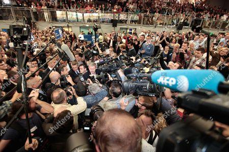 Nicolas Sarkozy mobbed by the press