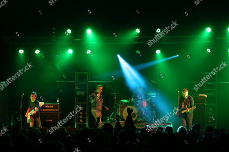 The Undertones - Damian O'Neill (left), Paul McLoone (2nd left), Billy Doherty (drums) and Michael Bradley (right)