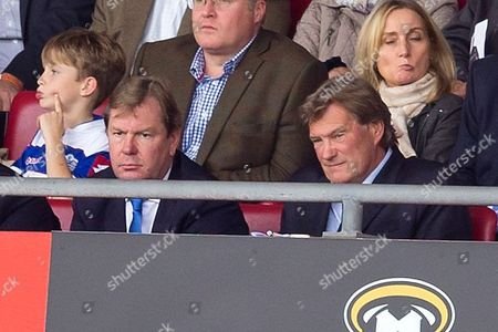 QPR Coach Glenn Hoddle watches from the stand along side QPR CEO Philip Beard