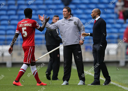 Cardiff City's Bruno Ecuele Manga is congratulated by Cardiff City caretaker managers Scott Young and Danny Gabbidon at the end of the match